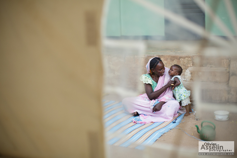 A woman and her child are seen through a window in a tent at a UNICEF-sponsored therapeutic feeding center at the Mongo hospital in the town of Mongo, Guera province, Chad on Tuesday October 16, 2012.