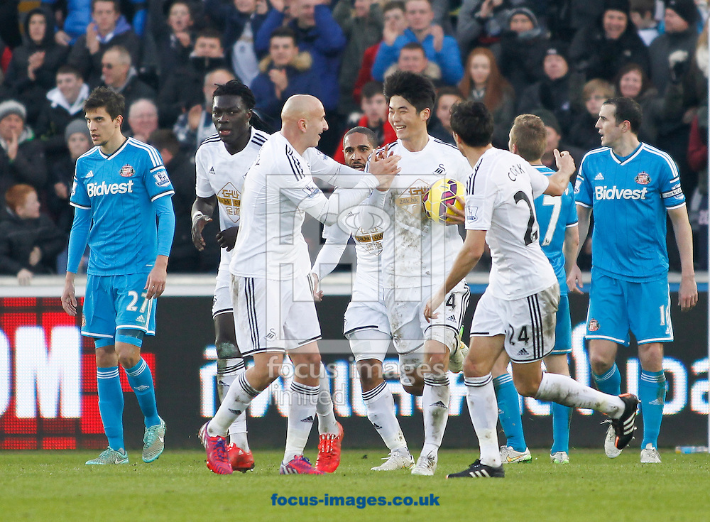 Ki Sung-Yeung (C) celebrates the first goal for Swansea City against Sunderland during the Barclays Premier League match at the Liberty Stadium, Swansea<br /> Picture by Mike Griffiths/Focus Images Ltd +44 7766 223933<br /> 07/02/2015