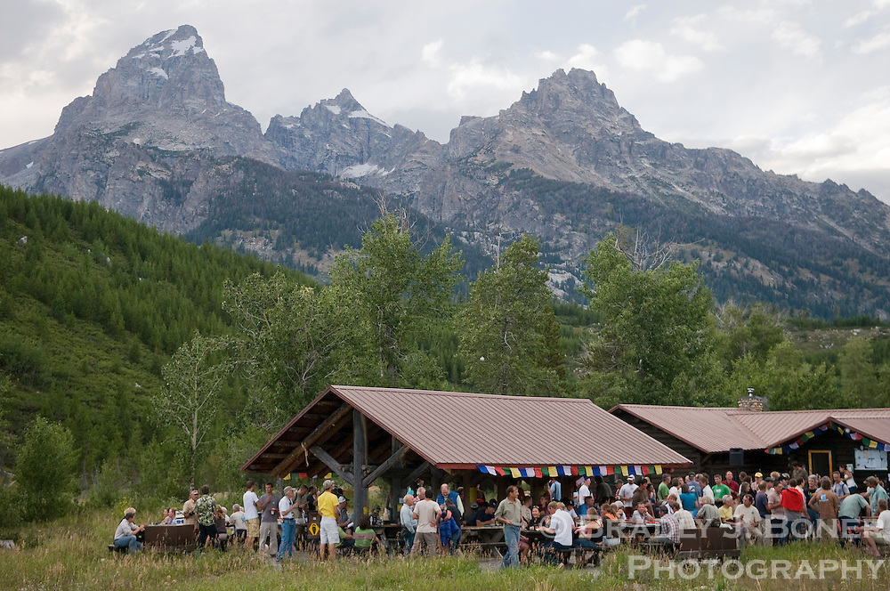 Attendees of the Grand Teton Climbers' Ranch 40th anniversary mingle and picnic in the commons area of the alpinist retreat in the shadow of the Tetons on Saturday evening.
