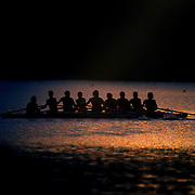 Rowers training at dawn on Lake Karapiro, near Cambridge, Waikato. Many national and international rowing competitions are held on Lake Karapiro which is also the home of The Rowing New Zealand High Performance Centre. Lake Karapiro hosted the 2010 World Rowing Championships. Lake Karapiro, Waikato,  New Zealand. 14th December 2010. Photo Tim Clayton