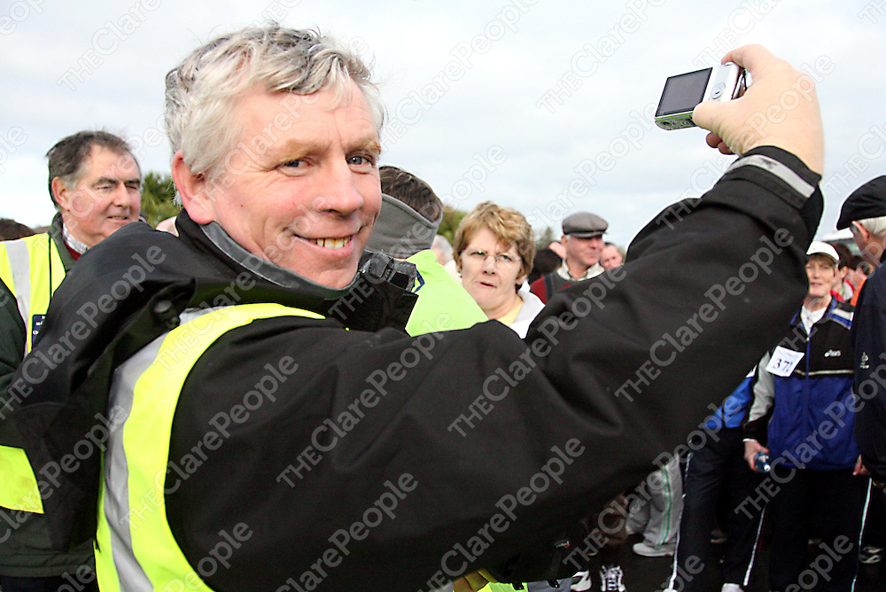 Gerry McGrath records the action on his camera at the 2007 West Clare Mini-Marathon from Kilrush to Kilkee on Sunday.<br />