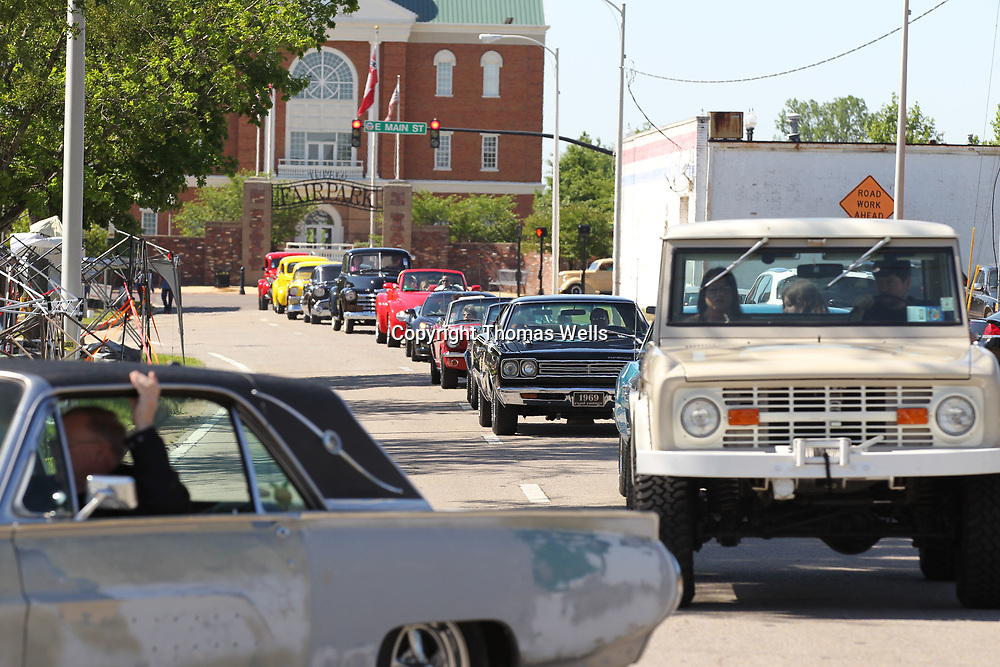 A long line of cars begin to from as they start arriving early Saturday morning for the annual Blue Suede Cruise at the BancorpSouth Arena.