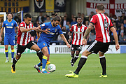 AFC Wimbledon defender George Francomb (7) battles for possession with Brentford defender Nico Yennaris (8) during the EFL Cup match between AFC Wimbledon and Brentford at the Cherry Red Records Stadium, Kingston, England on 8 August 2017. Photo by Matthew Redman.