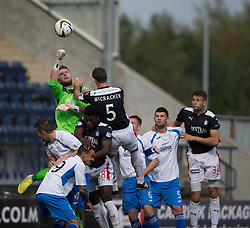 Queen of the South's keeper Zander Clark punches clear.<br /> Half time : Falkirk 0 v 0 Queen of the South, Scottish Championship game played today at The Falkirk Stadium.