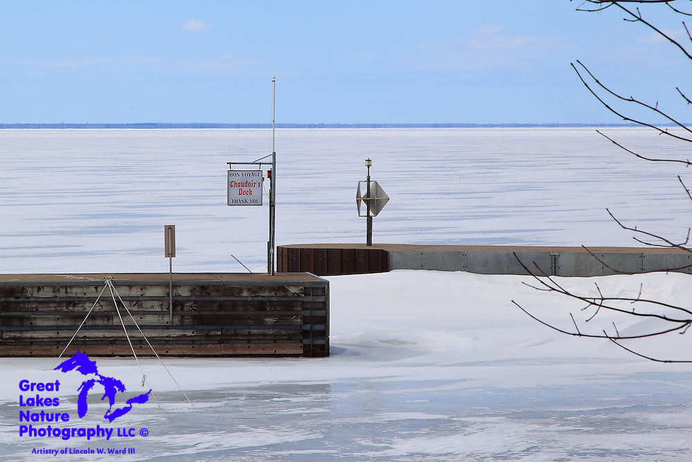 "In late March, 2013, I decided to roam and explore some of my favorite fishing spots for signs of spring. The ""Bon Voyage"" sign at the outlet of Chaudoir's Dock in Door County Wisconsin is almost humorous in this image, as winter was still in full control, and Green Bay was completely frozen. It remained that way for nearly another month."