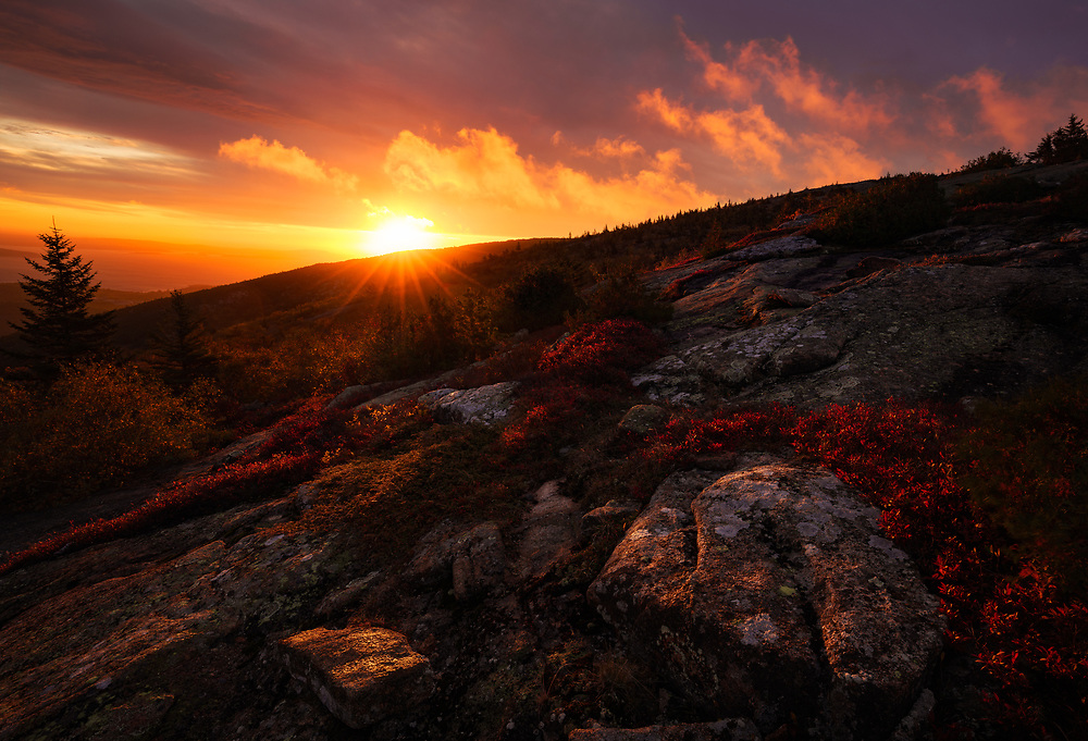 Dramatic sunrise as a storm breaks up, Cadillac Mountain,  Acadia National Park, Maine, USA