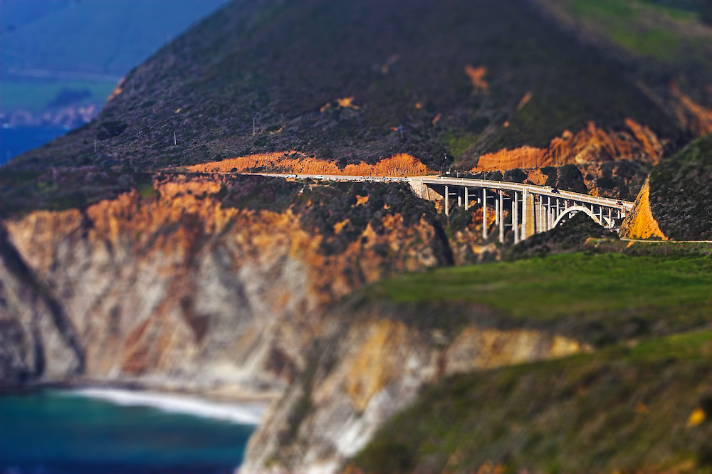 Concrete arch bridges are common along the Pacific coast throughout California. This one carries Route 1 high above an inlet off the ocean.