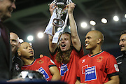 Eastbourne Borough's KANE HAYSMAN lifts the cup during the Sussex Senior Cup Final match between Eastbourne Borough and Worthing FC at the American Express Community Stadium, Brighton and Hove, England on 20 May 2016.