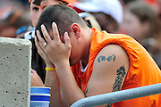 Sept. 19, 2010; Cleveland, OH, USA; A Cleveland Browns fan expresses his frustration with his team during the final minutes of the fourth quarter against the Kansas City Chiefs at Cleveland Browns Stadium. The Kansas City Chiefs beat the Cleveland Browns 16-14. Mandatory Credit: Jason Miller-US PRESSWIRE