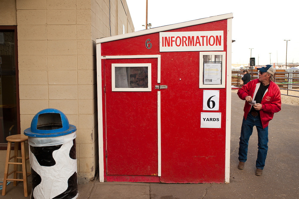 Information booth and cow trash can.