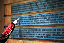 CENTRAL LONDON. A woman points at a name on the memorial wall. Family and friends of those killed in the World Trade Centre attacks in New York in 2001 visit the memorial to the British victims in Grosvenor Square.  11 September 2010. STEPHEN SIMPSON.