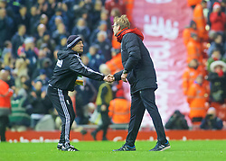 LIVERPOOL, ENGLAND - Sunday, December 13, 2015: Liverpool's manager Jürgen Klopp shakes hands with a West Bromwich Albion coach during the Premier League match at Anfield. (Pic by James Maloney/Propaganda)