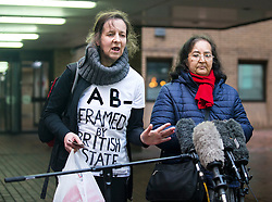 "© Licensed to London News Pictures. 29/01/2016. London, UK. JOSEPHINE HERIVEL (L) wearing a t-shirt with the words ""A B - FRAMED BY BRITISH STATE""  written on it, stands next to CHANDRA BALAKRISHNA (R), the wife of Aravindan Balakrishnan as she speaks to media as they leave Southwark Crown Court in London where Maoist cult leader Aravindan Balakrishnan has been sentenced to 23 years in prison for rape, child cruelty and false imprisonment. Aravindan Balakrishnan was found guilty of the rape of two of his followers and and false imprisonment of  his daughter for more than 30 years in a commune in south London.  Photo credit: Peter Macdiarmid/LNP"