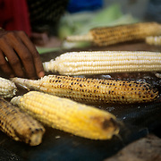 'Bhuta' or mase on the cob is popular during the summer months..Streetside vendors frantically fan their mobile coal fires, gently roasting the corn cobs while people line up to buy this popular Indian snack. Spicy Roasted Corn On The Cob, known as Bhutta in India, is best made with yellow corn with kernels that are not too soft. Each vendor has his own secret spice rub which he applies generously to the roasted corn.