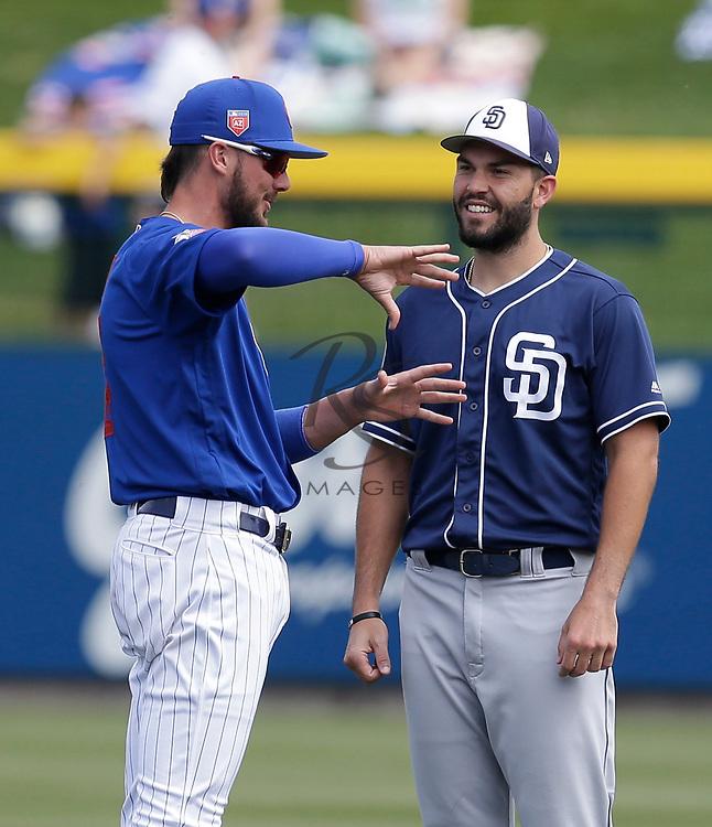 Mar 8, 2018; Mesa, AZ, USA; Chicago Cubs third baseman Kris Bryant (17) and San Diego Padres first baseman Eric Hosmer (30) talk before a game at Sloan Park. Mandatory Credit: Rick Scuteri-USA TODAY Sports