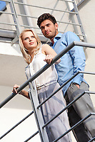 Young couple standing together at hotel balcony