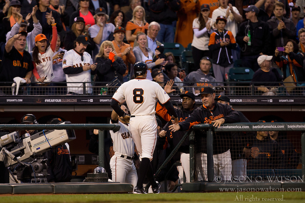 SAN FRANCISCO, CA - MAY 06: Hunter Pence #8 of the San Francisco Giants is congratulated by teammates after hitting a home run against the Philadelphia Phillies during the second inning at AT&T Park on May 6, 2013 in San Francisco, California. The Philadelphia Phillies defeated the San Francisco Giants 6-2. (Photo by Jason O. Watson/Getty Images) *** Local Caption *** Hunter Pence