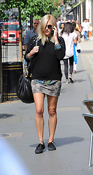 Pregnant Fearne Cotton wearing a black jumper over a pattern shirt, teamed with a skirt above the knee, dark shades and black lace up pumps. London. UK. 22/8/2012<br />BYLINE MUST READ : GOTCHAIMAGES.COM<br /><br />Copyright by © Gotcha Images Ltd. All rights reserved.<br />Usage of this image is conditional upon the acceptance <br />of Gotcha Images Ltd, terms and conditions available at<br />www.gotchaimages.com