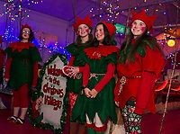 Santa's Elves welcomed visitors with Christmas cheer at Christmas Village Thursday evening.  (Karen Bobotas/for the Laconia Daily Sun)