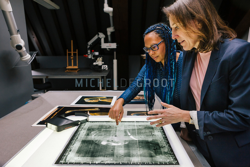 Paintings Conservator Abbie Vandivere (left) and Museum Director Emilie Gordenker (right) examining an X-ray photo of the iconic Johannes Vermeer painting &quot;Girl with the Pearl Earring&rdquo; at the Mauritshuis museum in The Hague, the Netherlands on February 15, 2018<br /> Photo: Michel de Groot