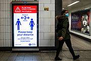 Keep 2m signs and Mind the Gap - Passenger numbers are down dramatically on the tube, even during rush hour as people heed government guidance. Those who do travel obey the signs that are everywhere and many wear masks. The 'lockdown' continues for the Coronavirus (Covid 19) outbreak in London.