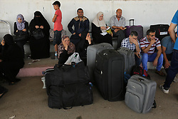 August 16, 2017 - Gaza City, Gaza Strip - Palestinians wait for travel permits to cross into Egypt through the Rafah border crossing after it was opened by Egyptian authorities for humanitarian cases, in Rafah in the southern Gaza Strip.  (Credit Image: © Ashraf Amra/APA Images via ZUMA Wire)