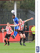 Yemi Odubade and Aaron Downes during the Vanarama National League match between Cheltenham Town and Eastleigh at Whaddon Road, Cheltenham, England on 17 October 2015. Photo by Antony Thompson.