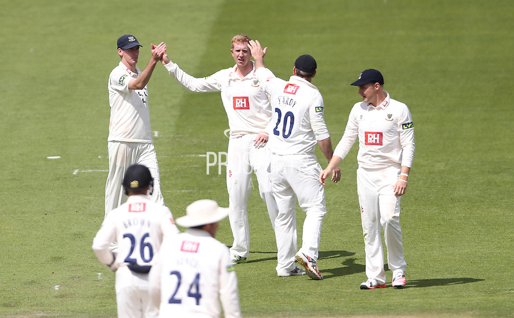 Luke Wells celebrates taking Fidel Edwards wicket with Luke Wright during the LV County Championship Div 1 match between Sussex County Cricket Club and Hampshire County Cricket Club at the BrightonandHoveJobs.com County Ground, Hove, United Kingdom on 8 June 2015.