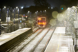 © Licensed to London News Pictures. 29/01/2019. STOKE MANDEVILLE, UK.  A train at Stoke Mandeville station. Rain is expected to turn to snow across large parts of the south of England and the Met Office has issued a yellow warning of snow and ice overnight.  Photo credit: Cliff Hide/LNP
