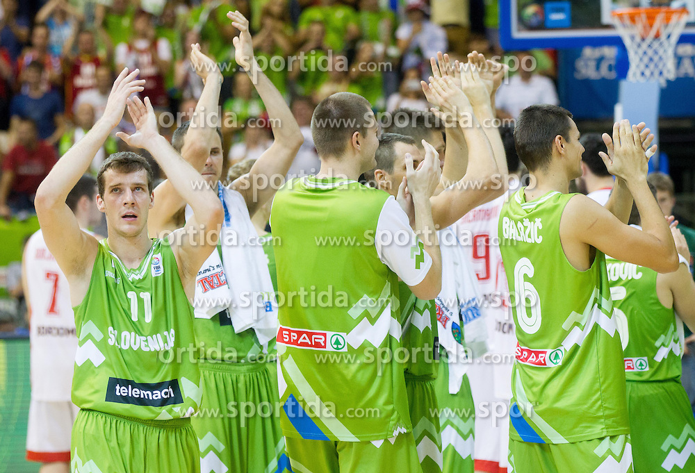 Goran Dragic of Slovenia and other players of Slovenia celebrate after winning the basketball match between National teams of Georgia and Slovenia in Round 1 at Day 4 of Eurobasket 2013 on September 7, 2013 in Arena Zlatorog, Celje, Slovenia. (Photo by Vid Ponikvar / Sportida.com)