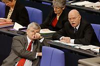 20 DEC 2002, BERLIN/GERMANY:<br /> Joschka Fischer (L), B90/Gruene, Bundesaussenminister, und Peter Struck (R), SPD, Bundesverteidigungsminister, im Gespraech, in der Regierungsbank, Plenum, Deutscher Bundestag<br /> IMAGE: 20021220-01-005<br /> KEYWORDS: Sitzung, Gespräch