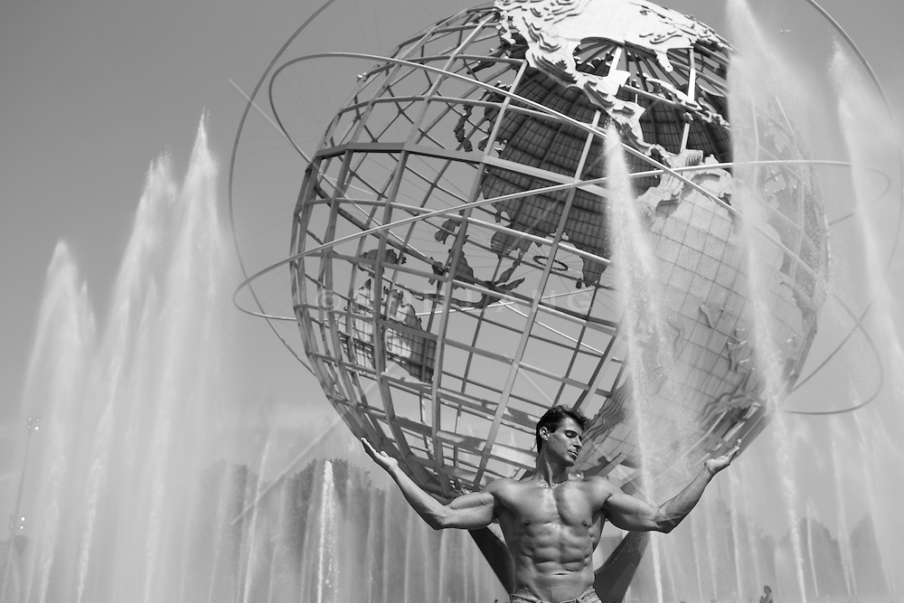 sexy man without a shirt in a New York City Fountain