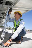 Maintenance worker adjusting solar panel in Los Angeles California