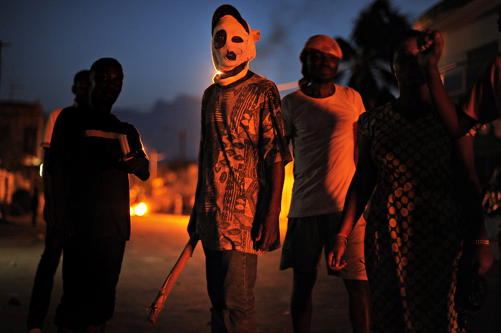 LOME, TOGO  13-05-25   - An opposition supporter masks his face to hide his identity. Protesters clashed with police in the Kodjoviakopé neighbourhood of Lome, Togo on the evening of Saturday, May 25, 2013.  Authorities have imposed a banned all protests in the capital city Lome after violent clashes this week.  Photo by Daniel Hayduk