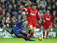 14/12/2004 - FA Barclays Premiership - Liverpool v Portsmouth - Anfield, Liverpool<br /> Liverpool's Alberto Nunez is tackled by Portsmouth hard working Lomana Lua Lua <br /> Photo:Jed Leicester/Digitalsport