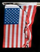burned American flag against a black background