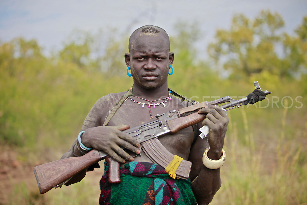 Third Price at PX3 2011 Prix de la Photographie | Paris<br /> Categorie: Advertising | Self-Promotion<br /> <br /> Mursi tribal man with an AK47 to protect his beloved cattle.<br /> Omo Valley, Ethiopia 2011