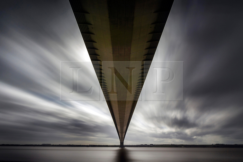 © Licensed to London News Pictures. 20/03/2018. Hull UK. A long exposure photograph shows the dark clouds moving over the Humber Bridge in Hull today on the first day of astronomical Spring. Photo credit: Andrew McCaren/LNP