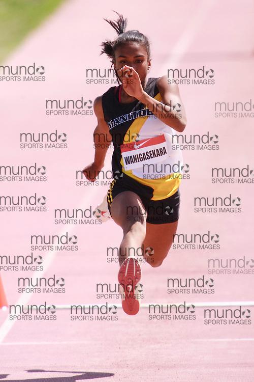 Winnipeg, Manitoba ---11-07-10---   Sasanie Wanigasekara competes in the triple jump at the 2011 Canadian Junior National Track and Field Championships in Winnipeg, Manitoba,  July 10, 2011..GEOFF ROBINS/ Mundo Sport Images.