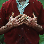 The hands of an An Irish farmer in County Lietrim speak to the years of toil and hard work while scratching out a living in this rural sector of Ireland.