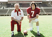 PALO ALTO, CA -  MARCH 1977:  Head coach Bill Walsh and quarterback Guy Benjamin of Stanford University pose on the field at Stanford Stadium in Palo Alto, California in March 1977. (Photo by David Madison/Getty Images) *** Local Caption *** Bill Walsh;Guy Benjamin