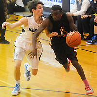 Hoggard's Charles Stanfield guards New Hanover's Acchaeus Fields Friday December 12, 2014 at Hoggard High School in Wilmington, N.C. (Jason A. Frizzelle)
