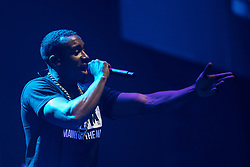 © Licensed to London News Pictures . 09/09/2017. Manchester , UK . Bugzy Malone performs . We Are Manchester reopening charity concert at the Manchester Arena with performances by Manchester artists including  Noel Gallagher , Courteeners , Blossoms and the poet Tony Walsh . The Arena has been closed since 22nd May 2017 , after Salman Abedi's terrorist attack at an Ariana Grande concert killed 22 and injured 250 . Money raised will go towards the victims of the bombing . Photo credit: Joel Goodman/LNP