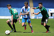 George Moncur of Colchester United looks to get past Matthew Lund of Rochdale and Joe Bunney of Rochdale during the Sky Bet League 1 match between Colchester United and Rochdale at the Weston Homes Community Stadium, Colchester<br /> Picture by Richard Blaxall/Focus Images Ltd +44 7853 364624<br /> 08/05/2016
