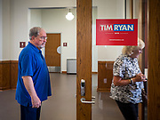 """01 JUNE 2019 - AMES, IOWA: People walk into a campaign event for Congressman Tim Ryan (D-OH). Ryan declared his candidacy for the US Presidency on the US television show """"The View"""" on April 4. Ryan represents Ohio's 13th District, which includes Lordstown, where a large General Motors plant recently closed. Iowa traditionally hosts the the first election event of the presidential election cycle. The Iowa Caucuses will be on Feb. 3, 2020.                PHOTO BY JACK KURTZ"""