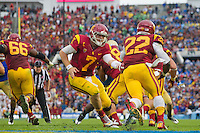 17 October 2012: Quarterback (7) Matt Barkley of the USC Trojans hands the ball off to (22) Curtis McNeal against the UCLA Bruins during the second half of UCLA's 38-28 victory over USC at the Rose Bowl in Pasadena, CA.