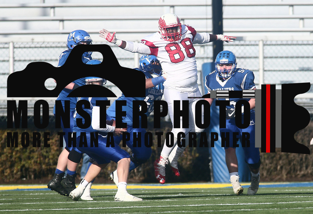Smyrna defensive linemen Jamier Smith (88) disrupted quarterback Drew Fry (8) during the DIAA division one Football Championship game between Top-seeded Middletown (11-0) and second-seeded Smyrna (11-0) Saturday, Dec. 03, 2016 at Delaware Stadium in Newark.
