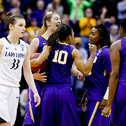 Mar 26, 2013; Baton Rouge, LA, USA; Penn State Lady Lions guard Maggie Lucas (33) walks off the court as LSU Tigers players celebrate a win during the second round of the 2013 NCAA womens basketball tournament at Pete Maravich Assembly Center. LSU defeated Penn State 71-66. Mandatory Credit: Derick E. Hingle-USA TODAY Sports