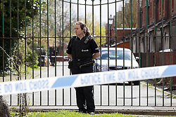 © Licensed to London News Pictures . 30/04/2013 . Salford , Greater Manchester , UK . Police have sealed off roads adjacent to the scene on the nearby Ordsall Estate . Police and forensic scenes of crime examiners at the scene on Regent Road , Salford , where a prison van was hijacked this morning (Tuesday 30th April) . Police report that two prisoners escaped . Photo credit : Joel Goodman/LNP