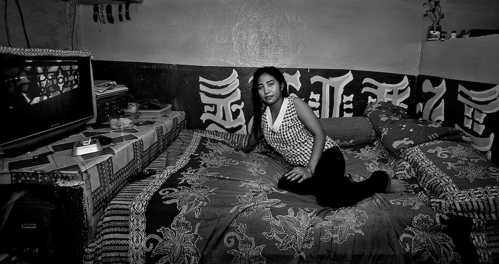 A brothel worker, Helda (27), in Tanjung Elmo is seen in her private room.